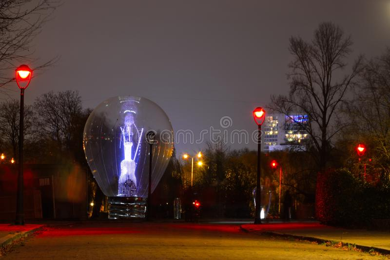Light-bulb at night. In blue vibrant colours at the light festival in Eindhoven, Netherlands stock photos