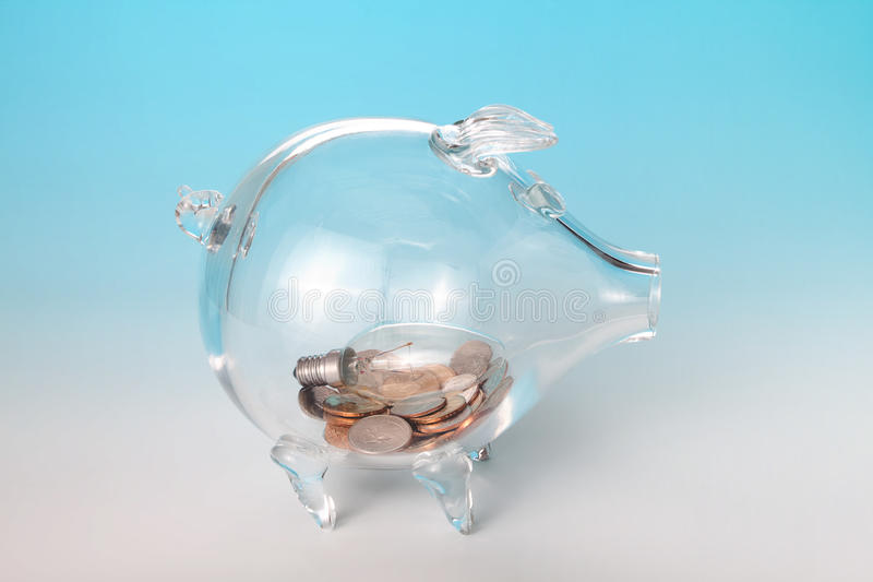 Light bulb in piggy bank royalty free stock photos