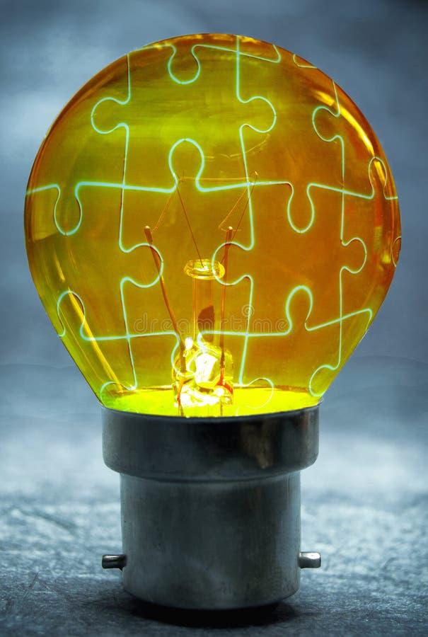 Light bulb puzzle stock photo