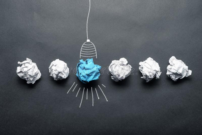 Light bulb sketch drawing with crumpled paper ball stock image