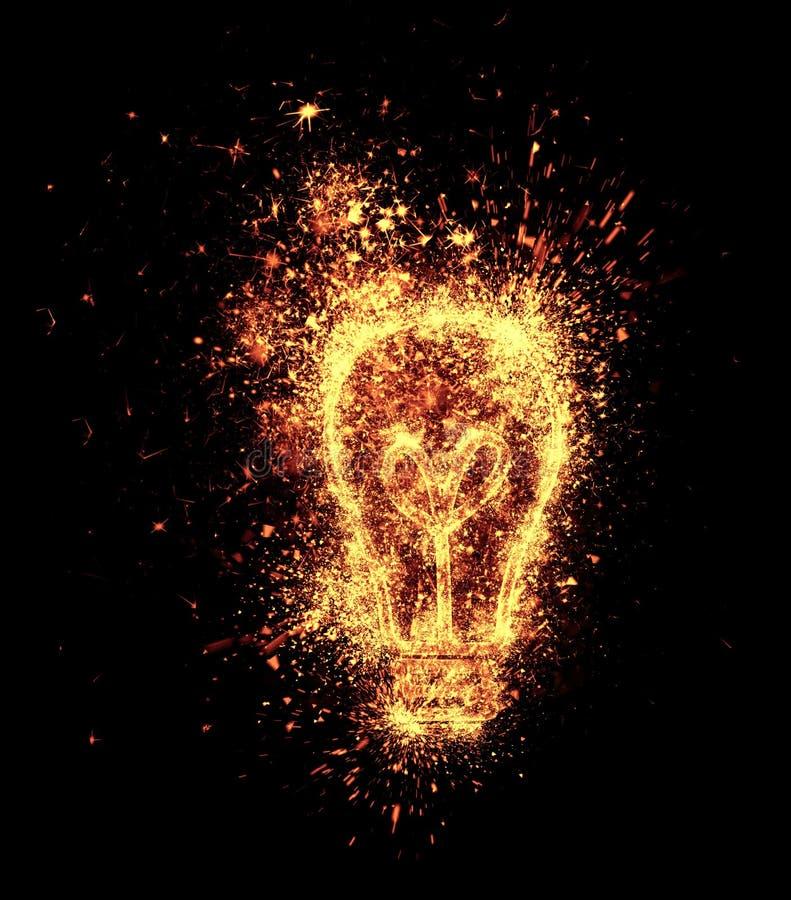 Light bulb symbol. Spark is isolated on black background stock photo