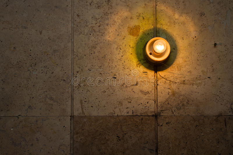 Light bulb on wall stock photos