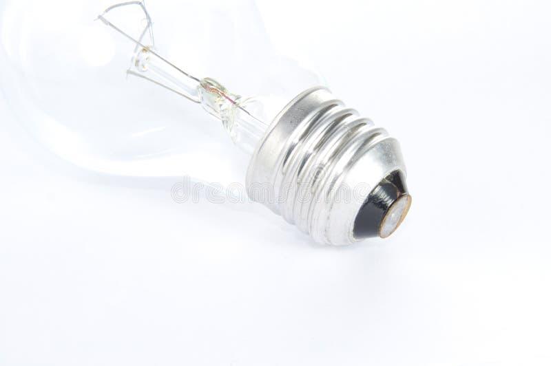 Light bulb on white stock photos