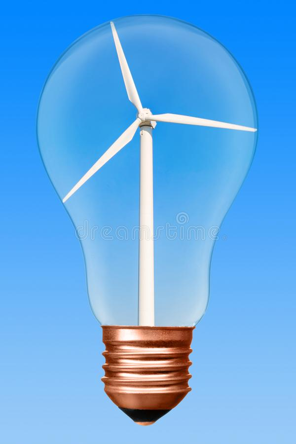 Light bulb with wind turbine inside on a blue gradient background. Conceptual picture royalty free stock photography