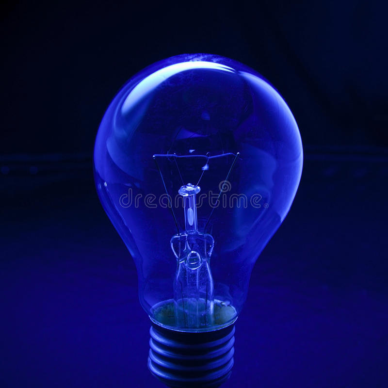 Free Light Bulb With Dark Blue Low Key Background Conception For Idea Creative Stock Photos - 28803003