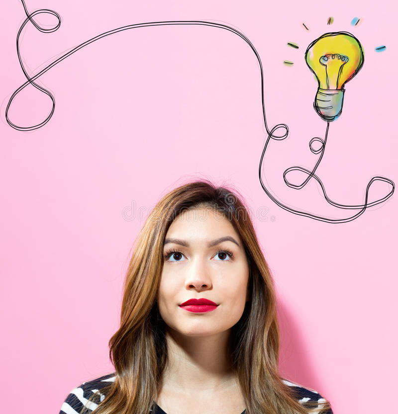 Light Bulb with young woman stock photo