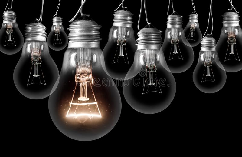 Light Bulbs Dark and Shining royalty free stock images