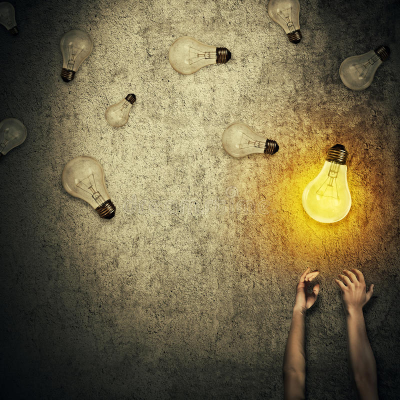 Light bulbs juggling royalty free stock image