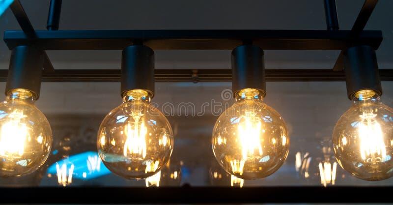 Light bulbs. A light mount with round incandescent light bulbs stock photos
