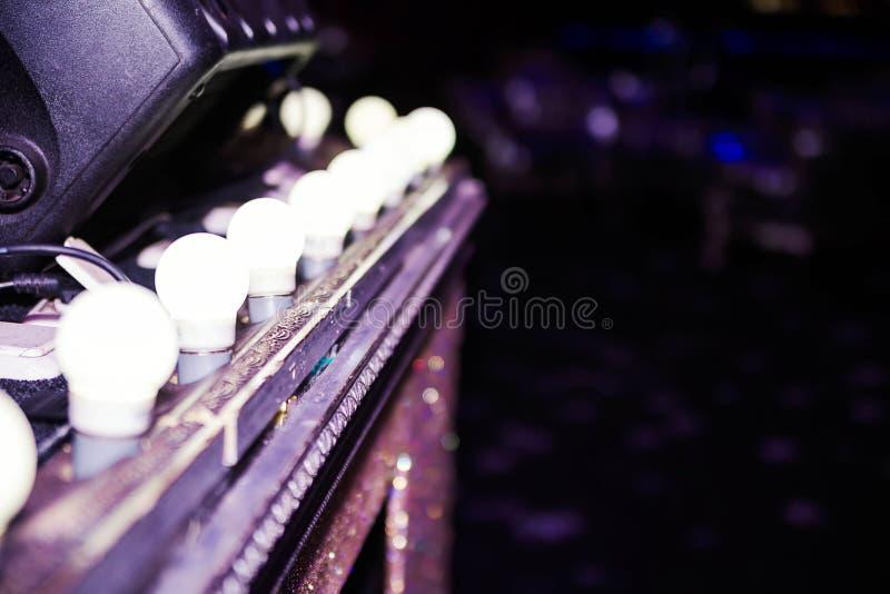 Light bulbs on the nightclub scene. Dark atmosphere in club royalty free stock photography