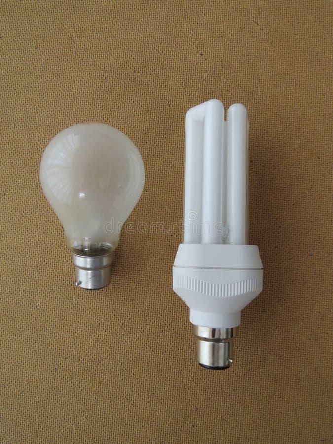Light Bulbs. Old & new. Energy saving bayonet fitting light bulb next to its older predecessor stock photography
