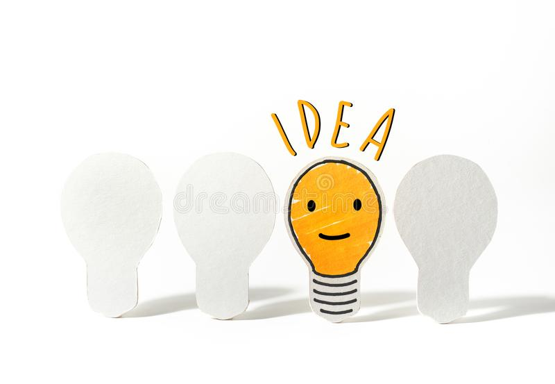 Light bulbs paper cut with emoticon face.Business ideas. Concept royalty free stock photography