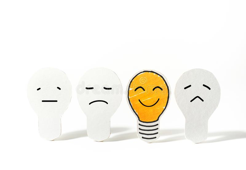 Light bulbs paper cut with emoticon face.Business ideas. Concept stock photo