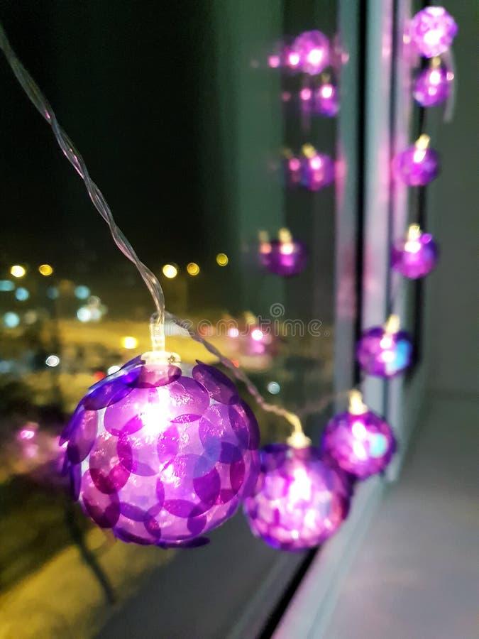 Light bulbs. Purple light bulbs in the dark winter evenings royalty free stock photography