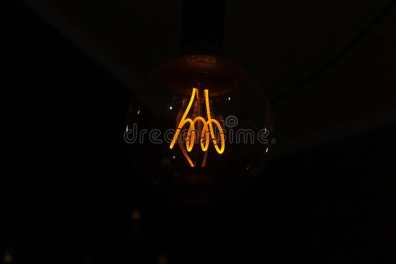 Light bulbs switched on and off, isolated on black background. Light bulbs switched on and off, isolated on black background royalty free stock photo