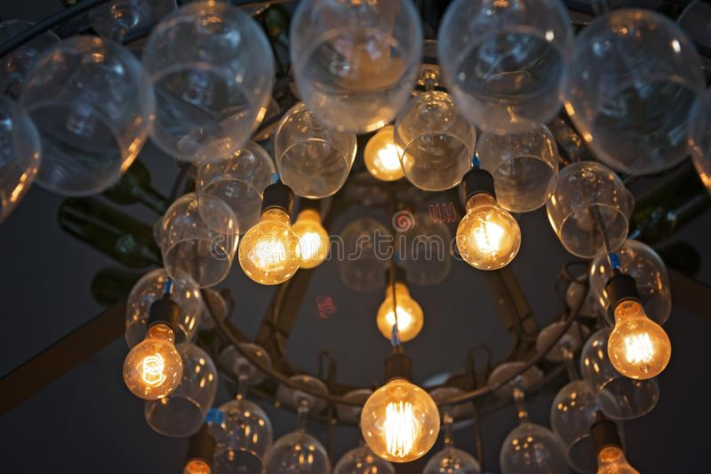 Light bulbs in a trendy bar. In downtown area royalty free stock image
