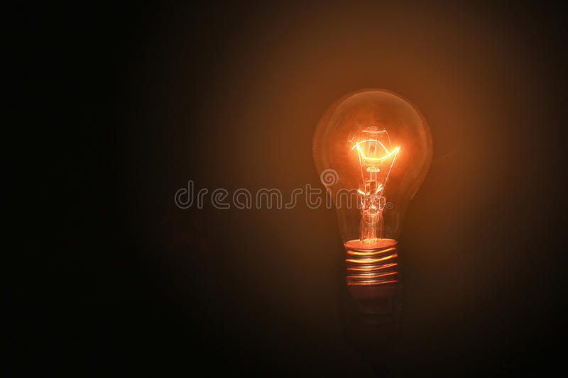 Light bulbs turn on on black background and no wiring with successful concept on thinking concept. Lighting in loft style stock images