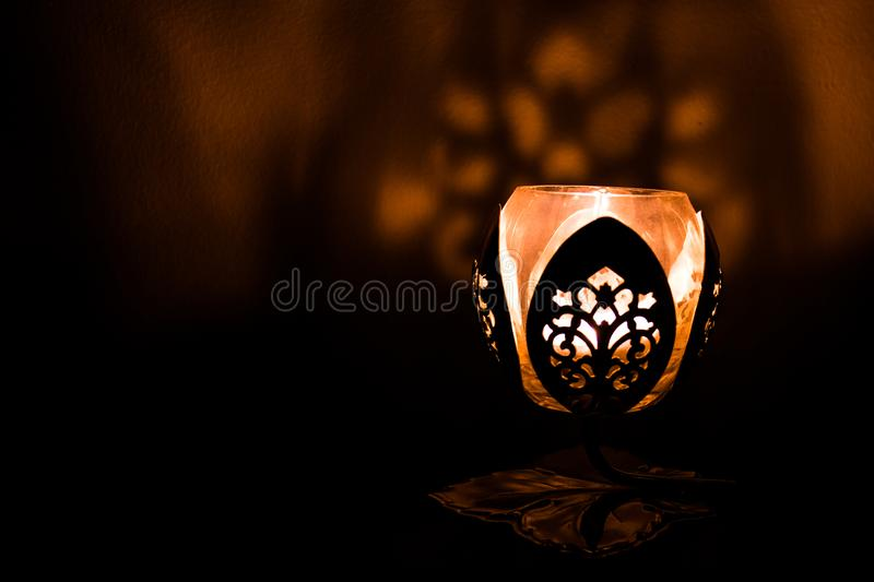 The light. The candle light with the shadow on the wall royalty free stock image