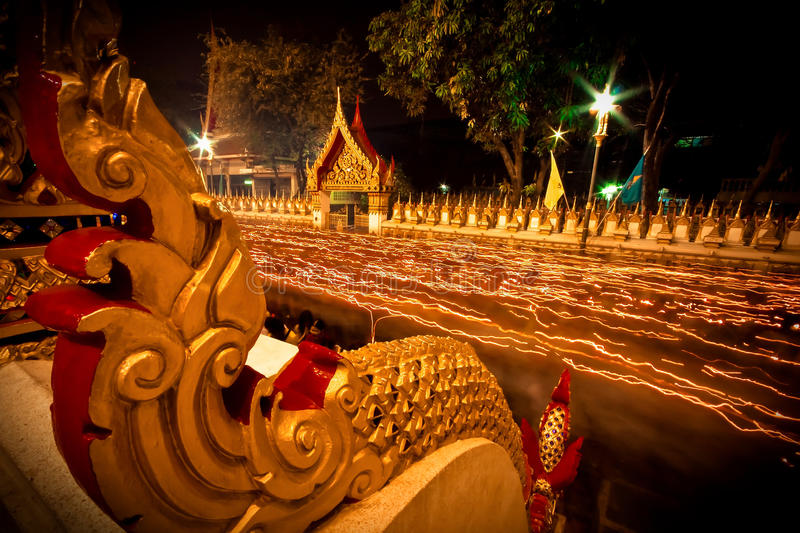 The light from the candle lit at night around the Church of Buddhist Lent. stock photography