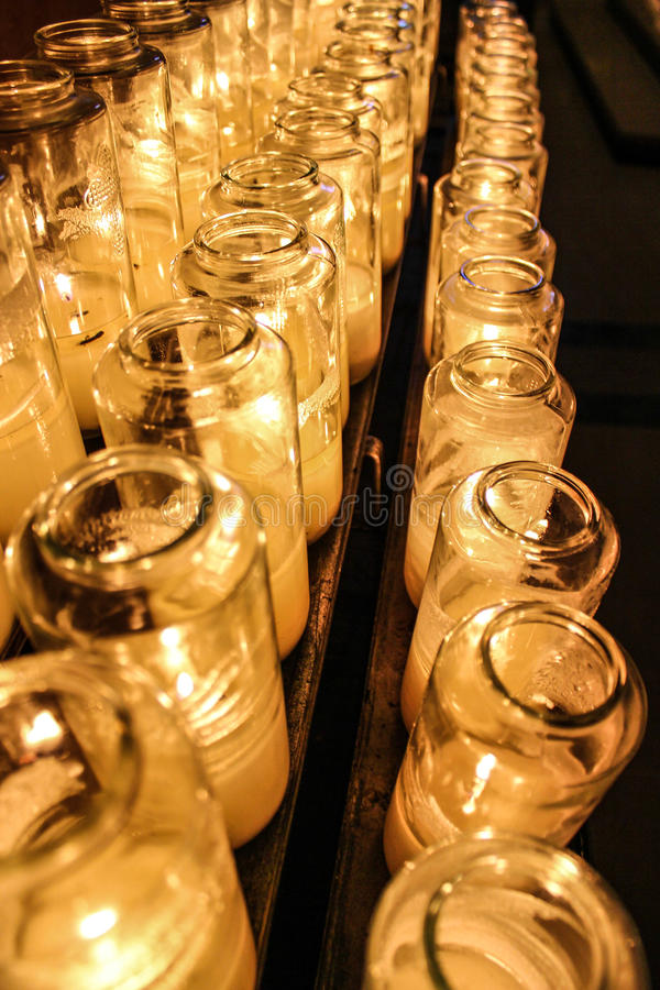 Light a candle for saint stock images