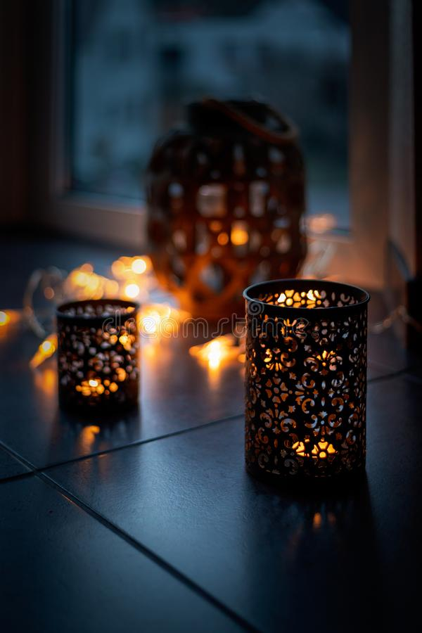 Light chain and candles create a cosy atmosphere. Romantic. Christmas.  stock image