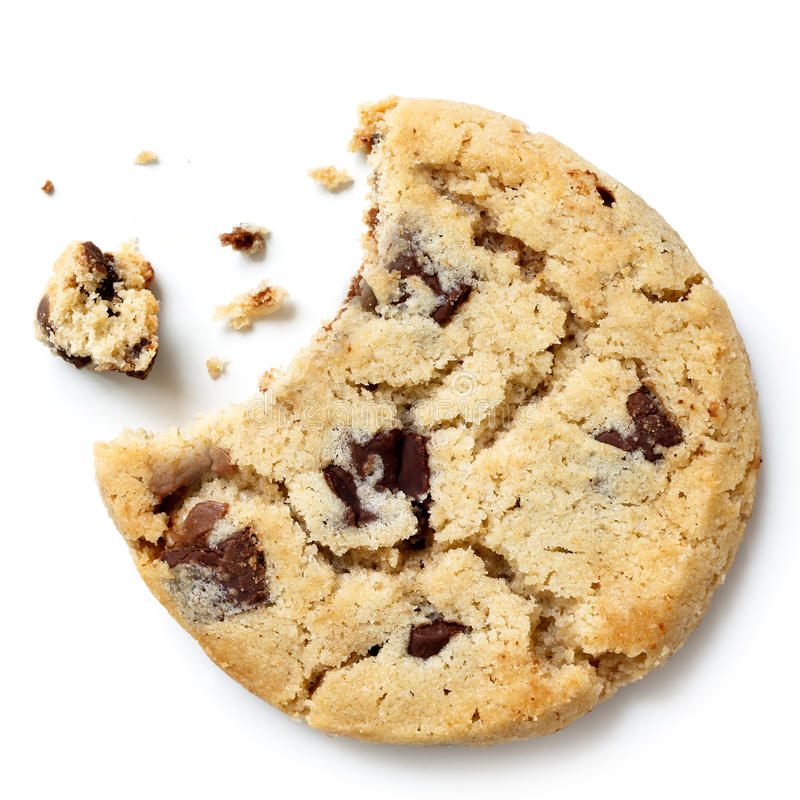 Light chocolate chip cookie, bite missing with crumbs from above.  royalty free stock image