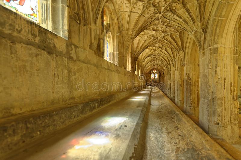 Light through the cloisters, gloucester cathedral. Film locations. Image shows shafts of colored light entering in through one of the cloisters of Gloucester stock photos