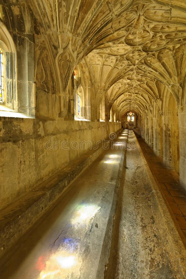 Light through the cloisters, gloucester cathedral. Film locations. Image shows shafts of colored light entering in through one of the cloisters of Gloucester stock photo