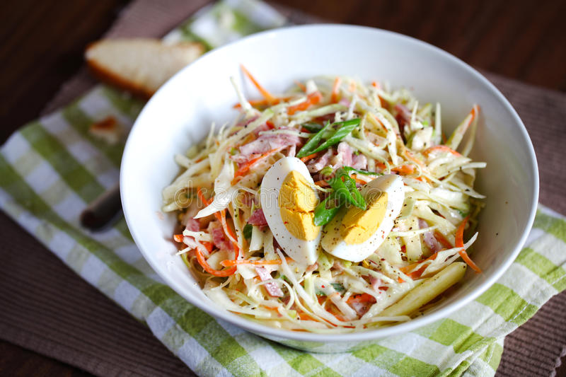 Coleslaw salad with hard boiled egg and apples. Light coleslaw salad with hard boiled egg, scallions and apples royalty free stock photos