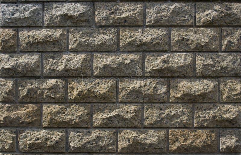 Light coloured stone brick wall cladding royalty free stock photos