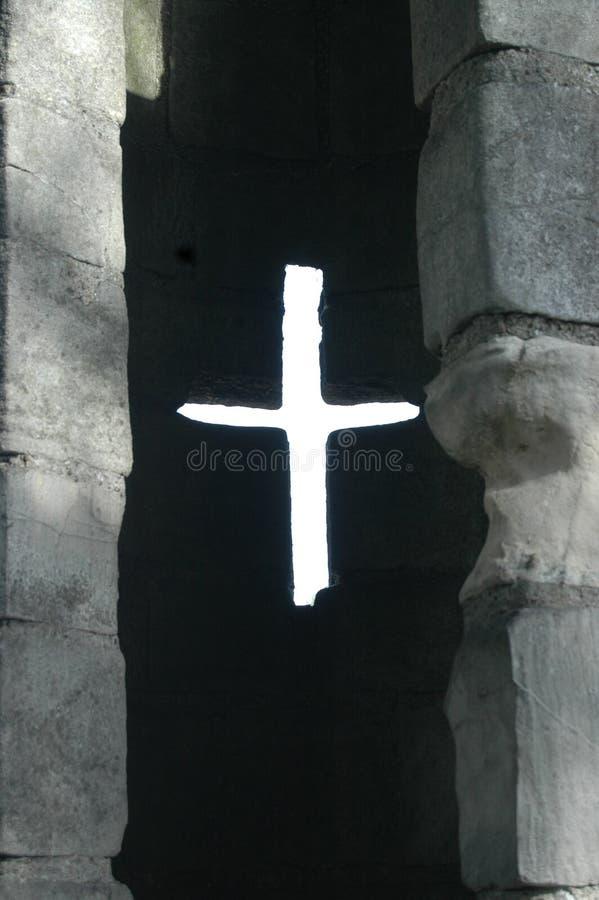 Light coming through cross shaped arrow slit. In York city walls royalty free stock photo