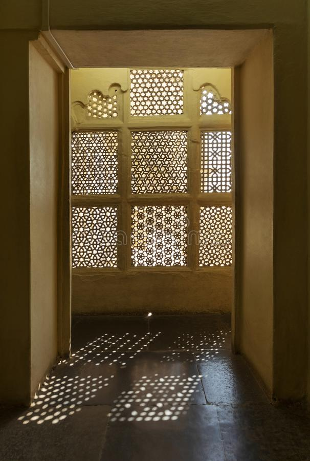 Light coming through fine window design, Udaipur, Rajasthan.  royalty free stock images