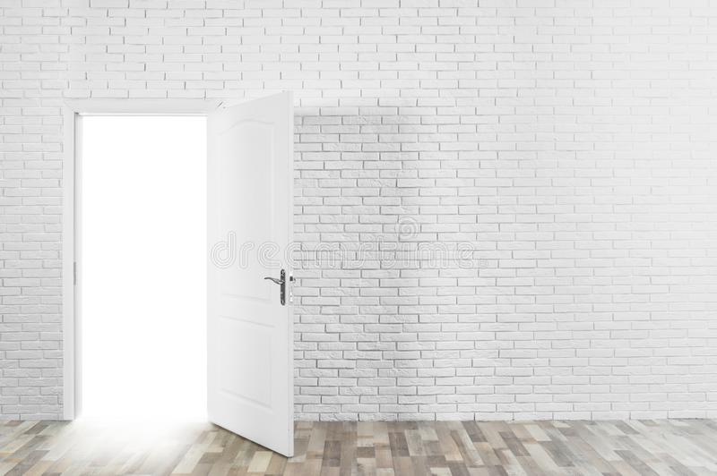 Light coming out through opened door in brick wall. Space for text royalty free stock photos