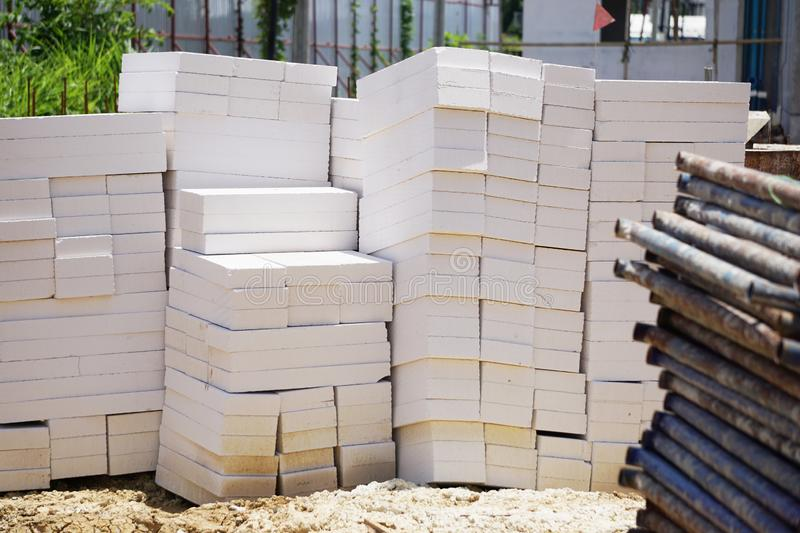 Light concrete blocks placed on the ground. stock photos