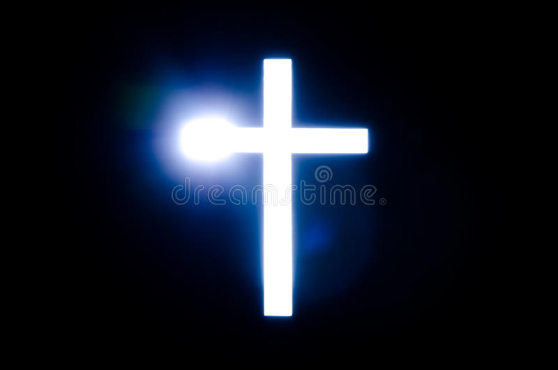 Light of Cross. Blue light from Cross in the darkness royalty free stock photo