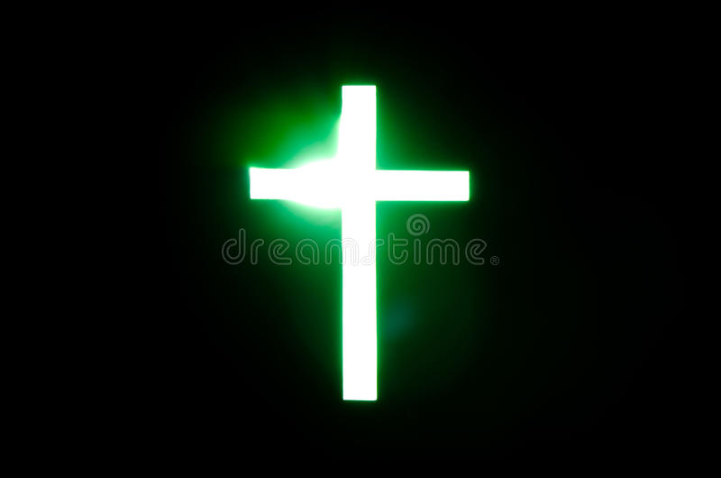 Light of Cross. Green light of Cross in black background royalty free stock images