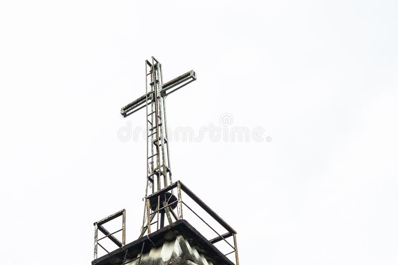 Light cross on the roof church from low angle view. Light cross on the roof church from low angle view royalty free stock photos