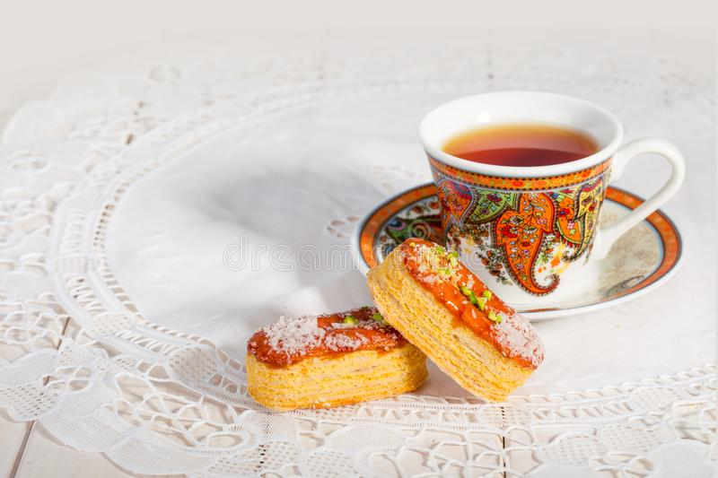 Light Crunchy Puff Layered Pastry Garnished With Pistachios & Co. Conut Flakes And A Traditional Cup Of Tea Popular Persian Sweets In Iran Called Zaboon Or Zaban royalty free stock photos
