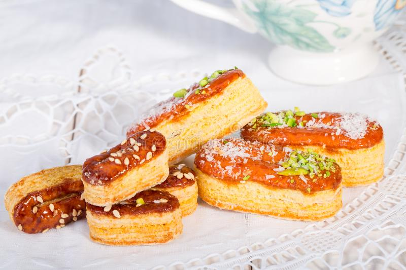 Light Crunchy Puff Layered Pastry Garnished With Pistachios & Co. Conut Flakes Popular Persian Sweets In Iran Called Zaboon Or Zaban royalty free stock photography