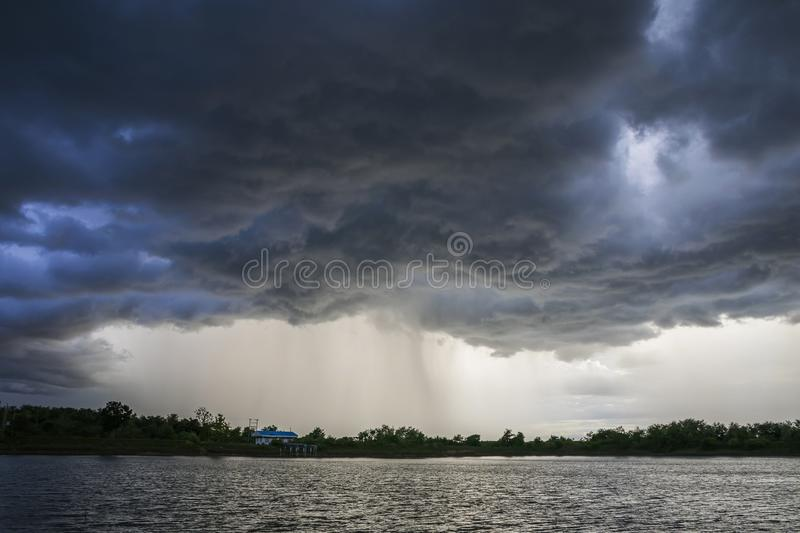 Light in the Dark and Dramatic Storm Clouds background. Black cumulus clouds before the beginning of a strong storm atmosphere backdrop beautiful blue bright royalty free stock photography