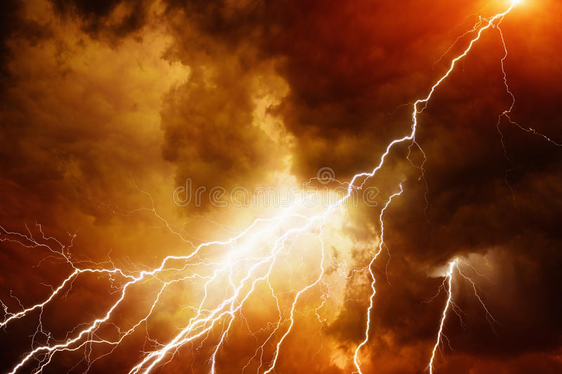 Light in dark red sky. Apocalyptic dramatic background - bright lighnings in dark red stormy sky, judgment day, armageddon stock image