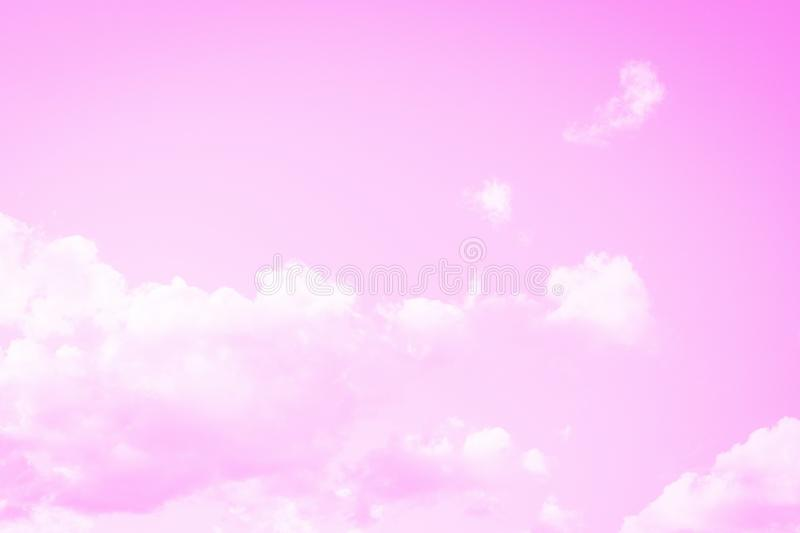 Light soft pink sky background. Beautiful romantic sky with white clouds royalty free stock photo