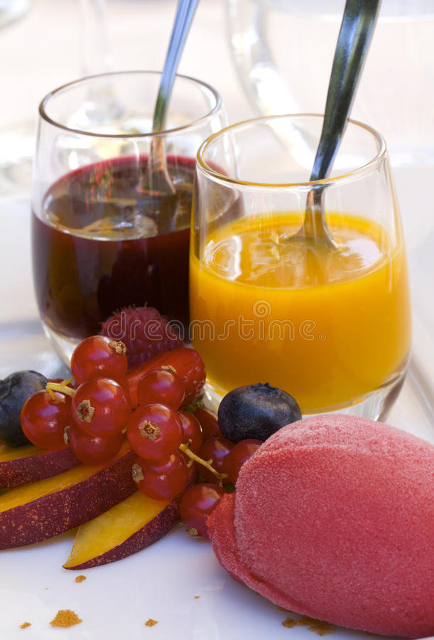 Light dessert. Ice cream, fresh fruit and sauces, a delicious dessert royalty free stock photography