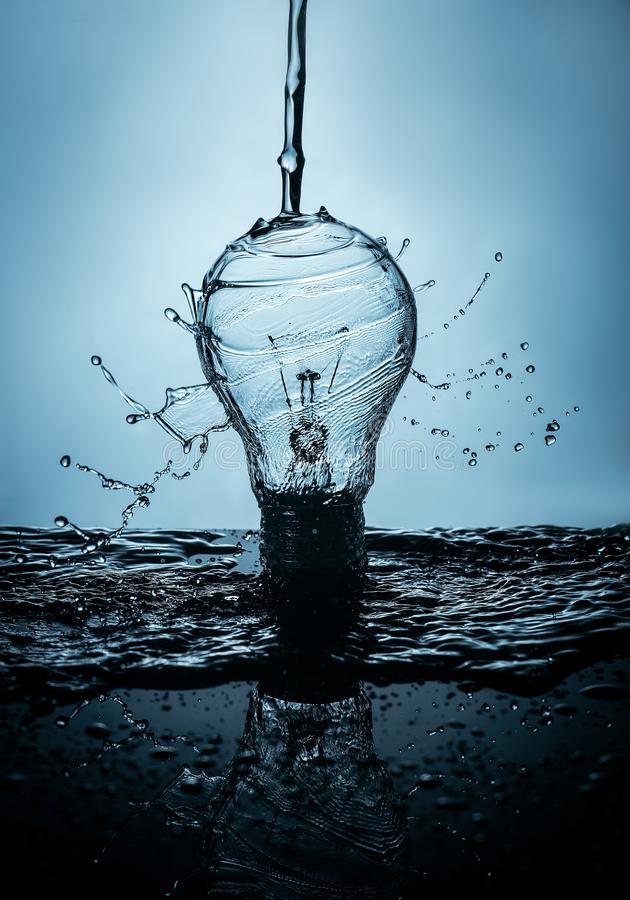 Bulb in water and spray royalty free stock image