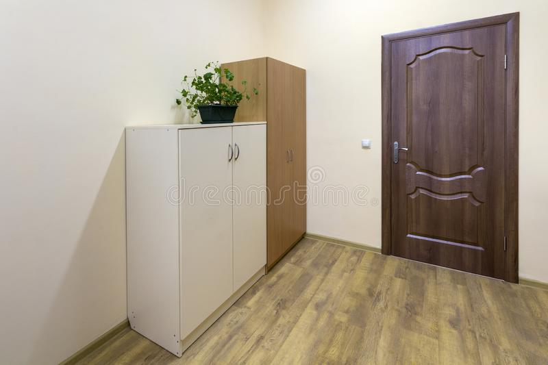 Light empty corridor hall with wooden floor, brown doors and sink. School, office or clinic interior.  stock images