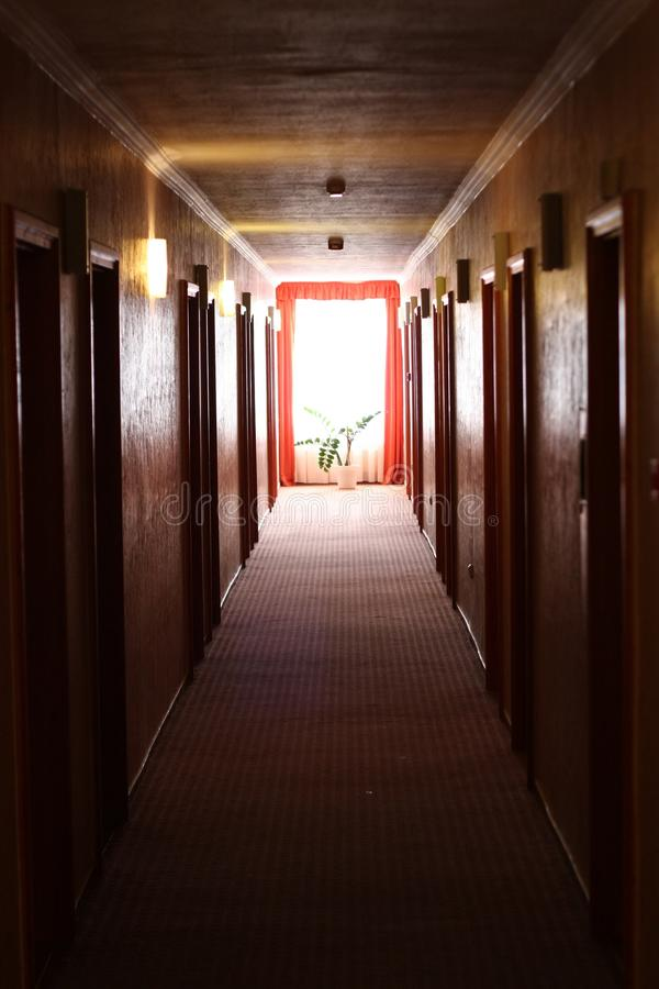Light on the end of a corridor stock image