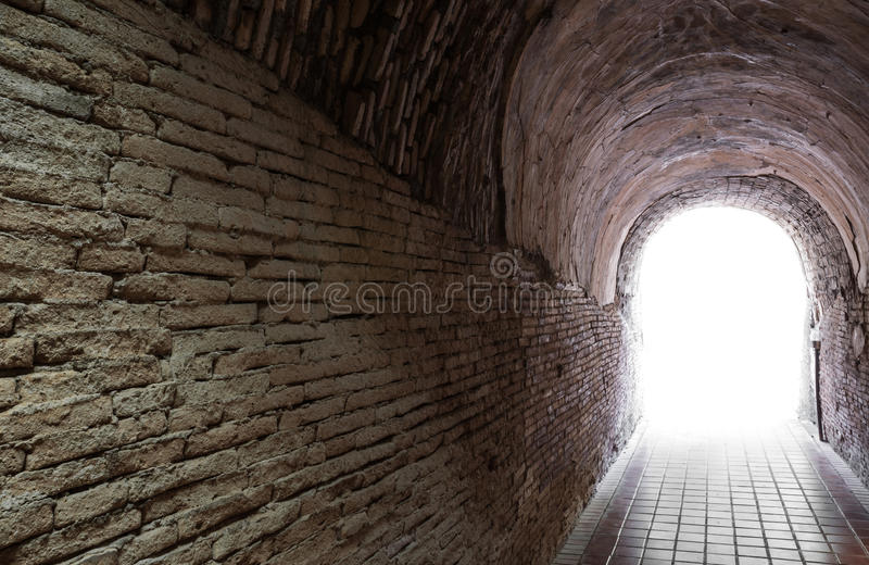 Light at the end of tunnel. Light at the end of ancient tunnel concept for hope or freedom stock photo