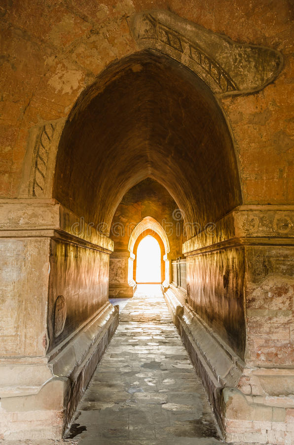 Light at end of tunnel in ancient Htilo Minlo pagoda. Light at end of tunnel in ancient Htilo Minlo pagoda, Archaeological site, Bagan, Myanmar stock photos