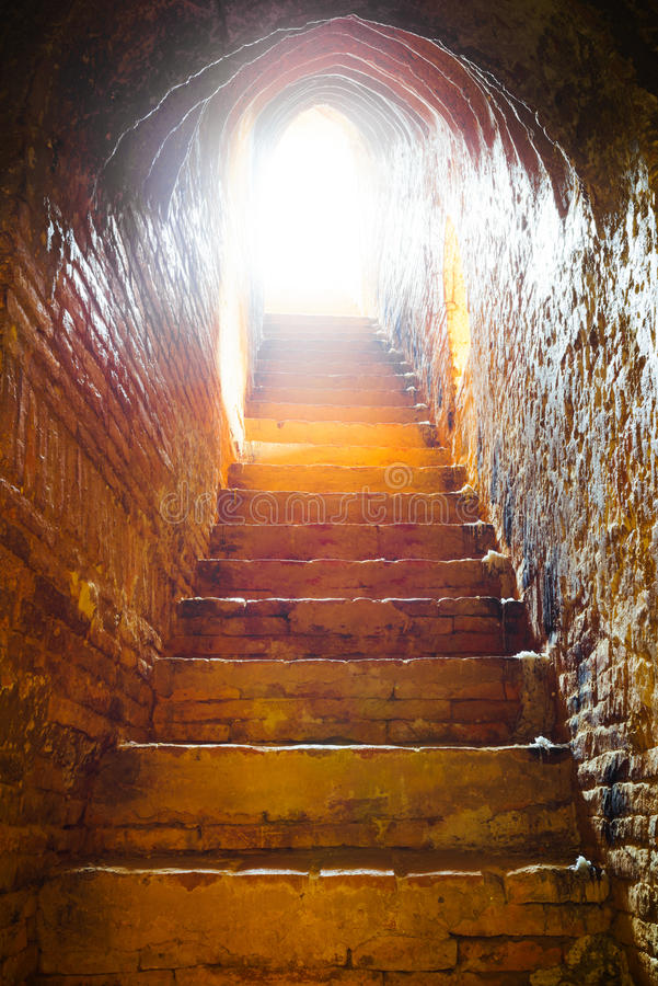 Light at end of tunnel in castle stock images