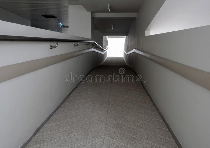 Light at the exit of the corridor in the building royalty free stock image